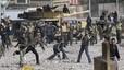 Enfrentamientos entre partidarios y opositores al régimen de Hosni Mubarak, en el centro de El Cairo.